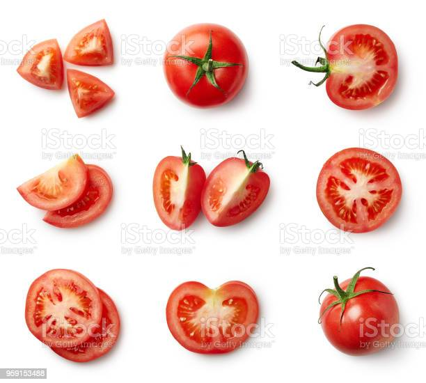 Set of fresh whole and sliced tomatoes isolated on white background. Top view