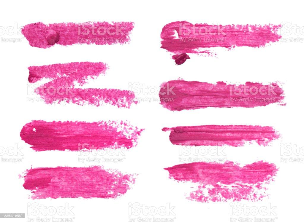 Conjunto de manchas de lápiz labial fucsia aislado sobre fondo blanco. - foto de stock