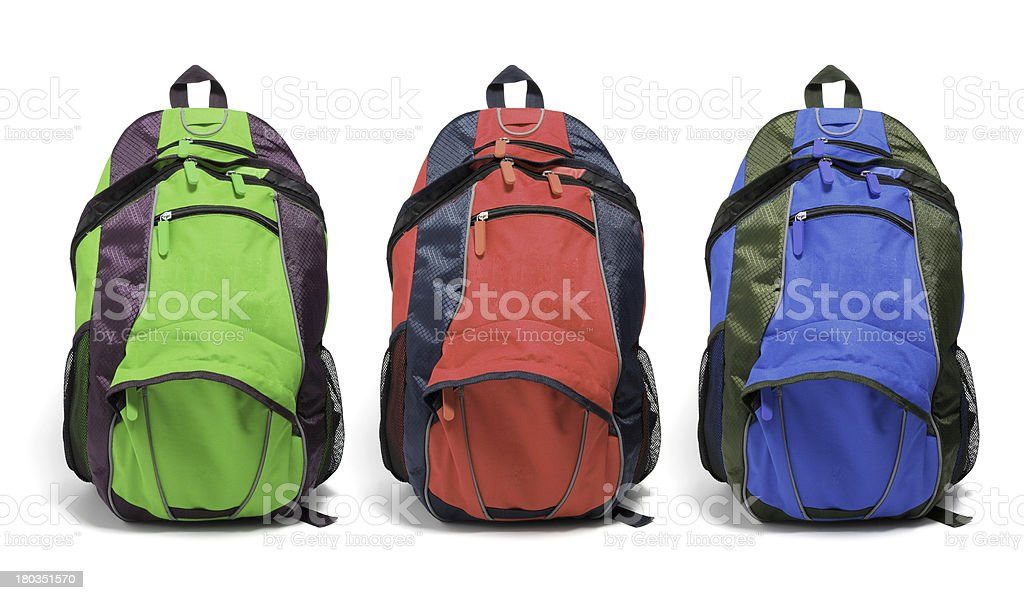 Set of full hiking backpacks on white background stock photo