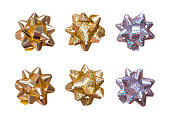 istock A set of gift bows isolated on white background. Gold and silver foil decorations. 700072908