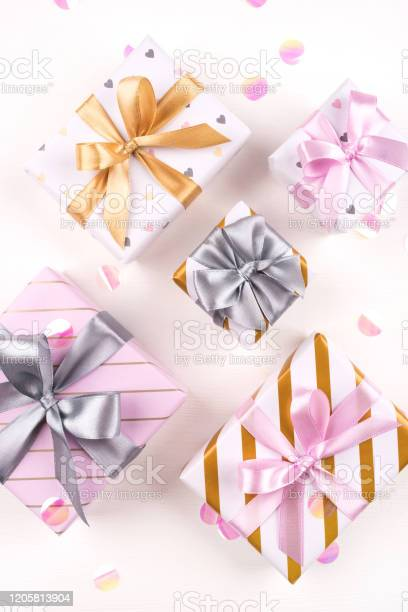 Set of gift boxes with bows and confetti on a white background picture id1205813904?b=1&k=6&m=1205813904&s=612x612&h=jkne5jmjtkqyeotmt pivatjgaic8pmnjhurqluyfta=