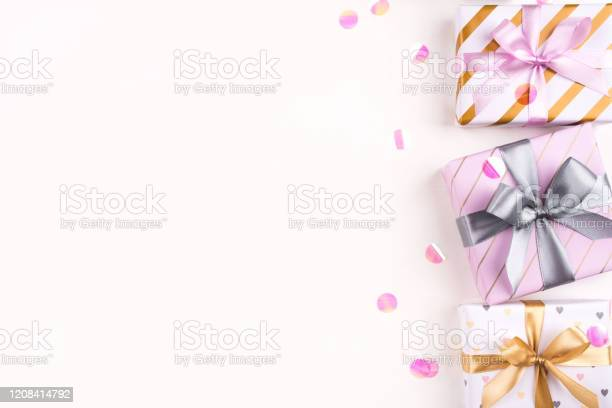 Set of gift boxes with bows and confetti on a white background picture id1208414792?b=1&k=6&m=1208414792&s=612x612&h=bx4cxqnosqnmzniy6b26di4pqm pmitdjew0l0pfpku=