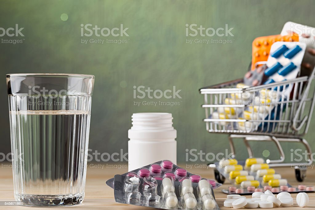 Set of glass water and pill blister packs stock photo