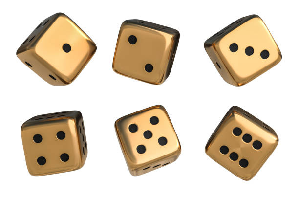 Set of golden dice with black dots isolated on white background stock photo