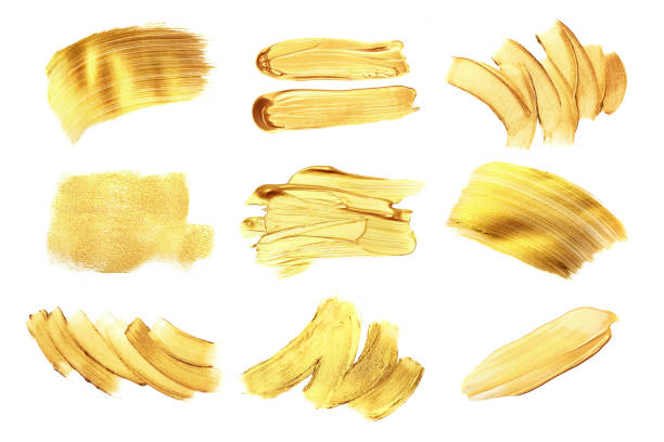 Set of golden paint strokes, isolated on white. Set of golden paint strokes for your design. Isolated on white background. Each element can be used also like background for text. make up brush stock pictures, royalty-free photos & images