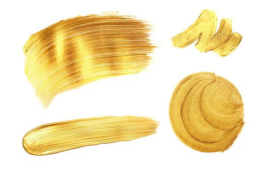 1202746861 istock photo Set of golden paint strokes, isolated on white. 1035835102