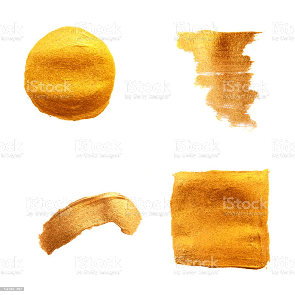 Set of golden painted brushes. Shining texture gold acrylic stain isolated on white background. stock photo