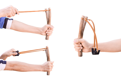 Set of hand holding aiming Slingshot, Isolated on white background with clipping path.