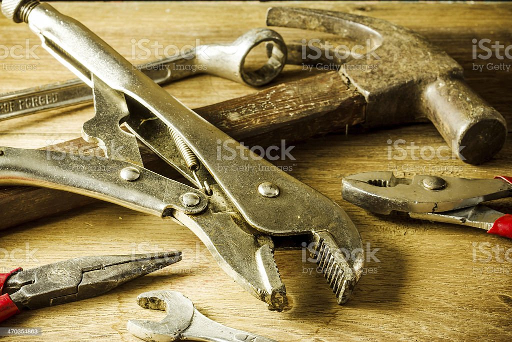 set of hand tools on a wooden panel royalty-free stock photo