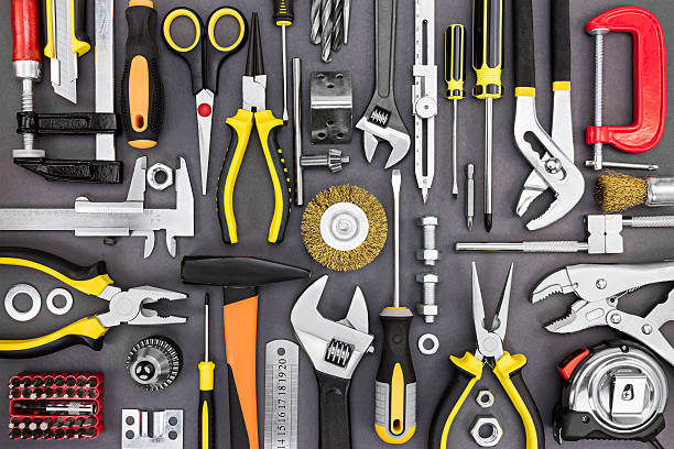 set of hand various work tools on grey background - werkzeuge stock-fotos und bilder