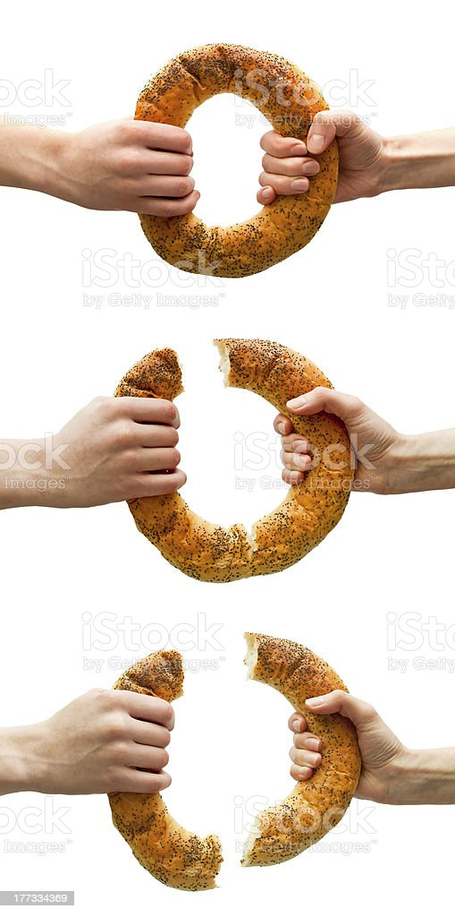 Set of hands breaking ring bread stock photo