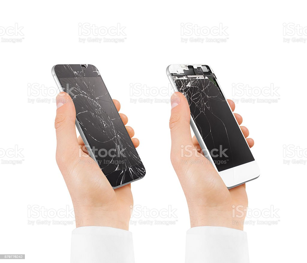 Set of hands holding broken phones with smashed touch screen. stock photo