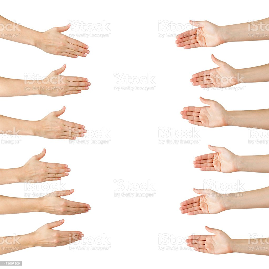 A set of hands offering to handshake with the other set stock photo