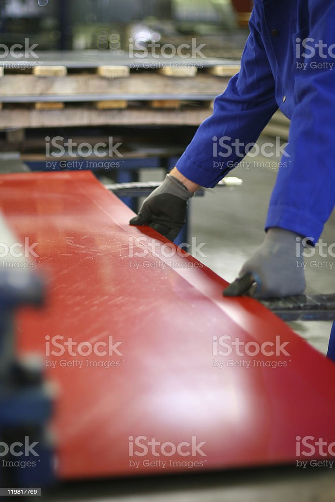 A set of hands working on a red surface stock photo
