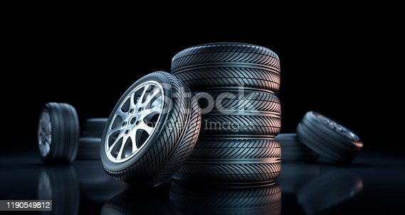 Isolated Car Tires and Wheels on dark Background  - 3D illustration