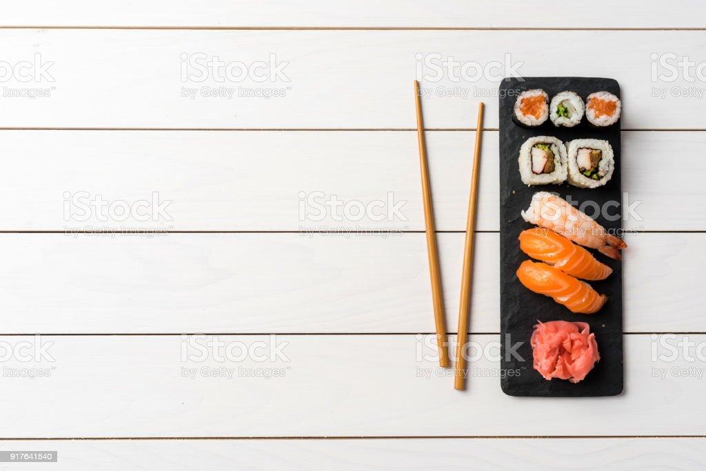 Set of Japanese sushi on white wooden table stock photo
