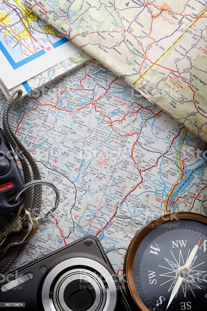 Set Of Keys,Camera, And A Compass On A Road map royalty-free stock photo