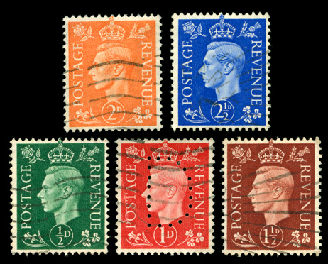 Old used stamps of Great Britain scanned on black background. In aRGB colorspace for optimal printing.
