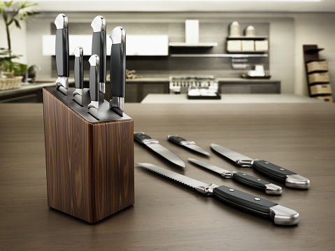 Set of kitchen knives standing on the table.