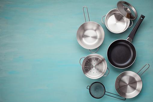 Set of kitchen metallic pans. Mockup, kitchen utensils, recipe book, cooking classes concept