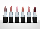 Set of lipsticks nude colors. Beige lipstick in a row isolated on white. 3d illustration of lipstick natural color.