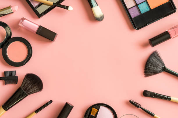 set of make up brushes and cosmetics on pink background - make up imagens e fotografias de stock