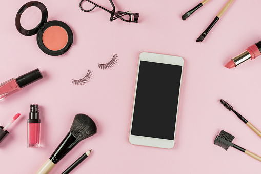 Set of make up brushes and cosmetics with smart phone
