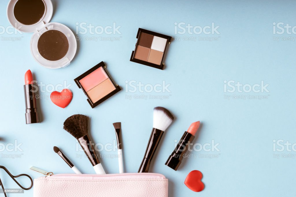 Set of Makeup cosmetics products with bag on top view, vintage style stock photo