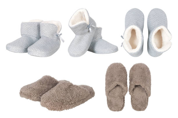 set of male and female slippers stock photo