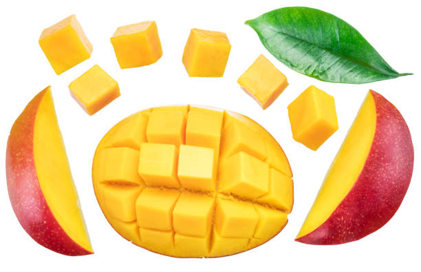 Set of mango cubes and mango slices isolated on a white background. File contains clipping path. stock photo