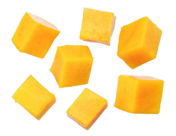 Set of mango cubes isolated on a white background. stock photo