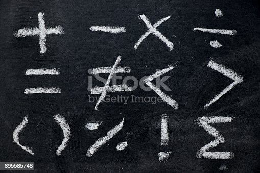 istock Set of math symbol draw by white chalk on blackboard background 695585748