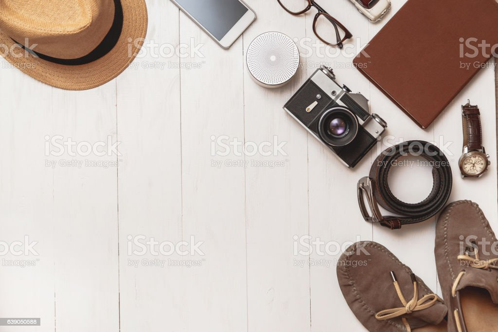Set of men's accessories on a white wooden background. stock photo