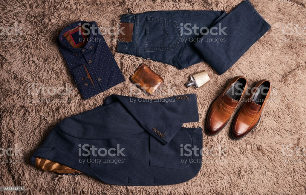 Set of men's clothes such as dark suit jacket stock photo