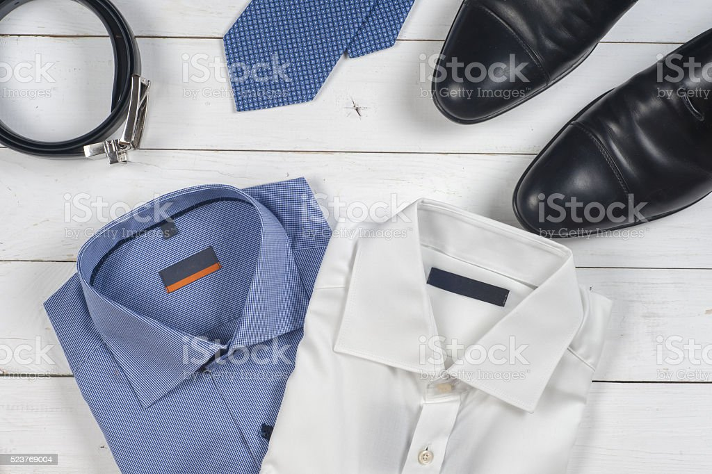 set of men's clothing and shoes on wooden background. stock photo