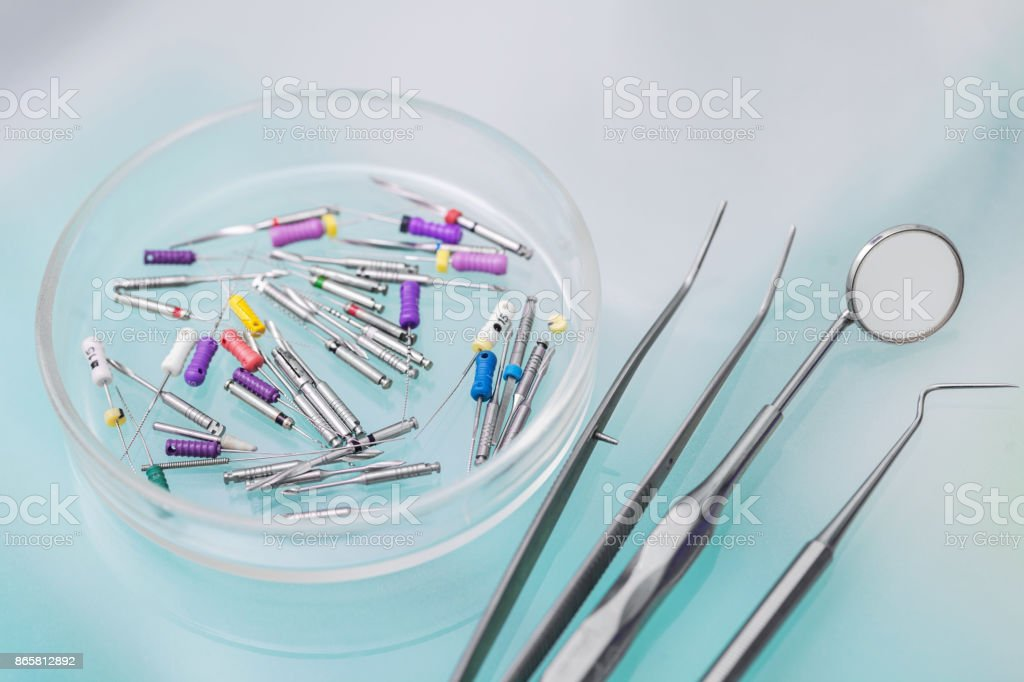Set of metal Dentist's medical equipment tools stock photo