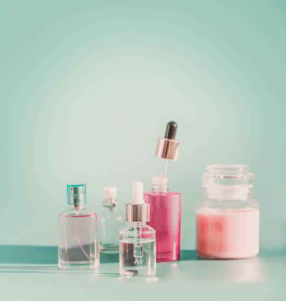 set of modern facial skin care cosmetics at blue background - serum stock photos and pictures