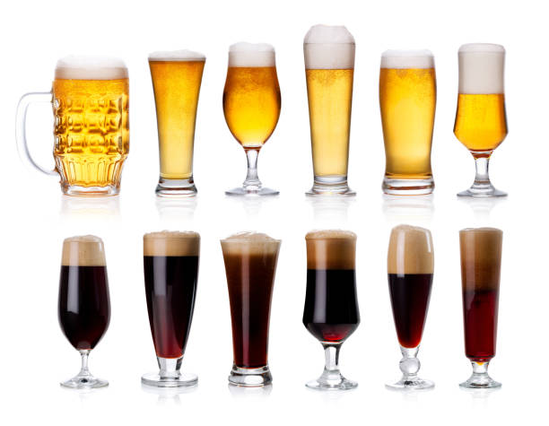 set of mugs and glasses with light and dark beer isolated on white stock photo
