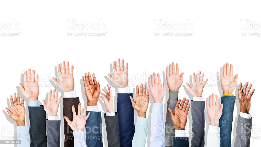 Set of multi ethinic hands raised in the air stock photo