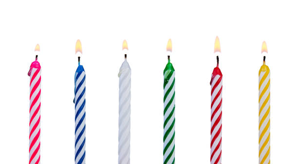 Set of multicolored candles for festive cupcake isolated on white background A set of multicolored candles for festive cupcake isolated on white background birthday candle stock pictures, royalty-free photos & images