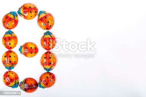 istock set of multicolored ladybugs forming an number 8 in Mexican ceramics 1066566814