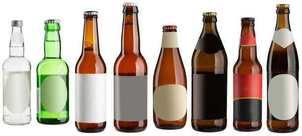 Set of multiple beer bottles with blank stickers isolated on white stock photo