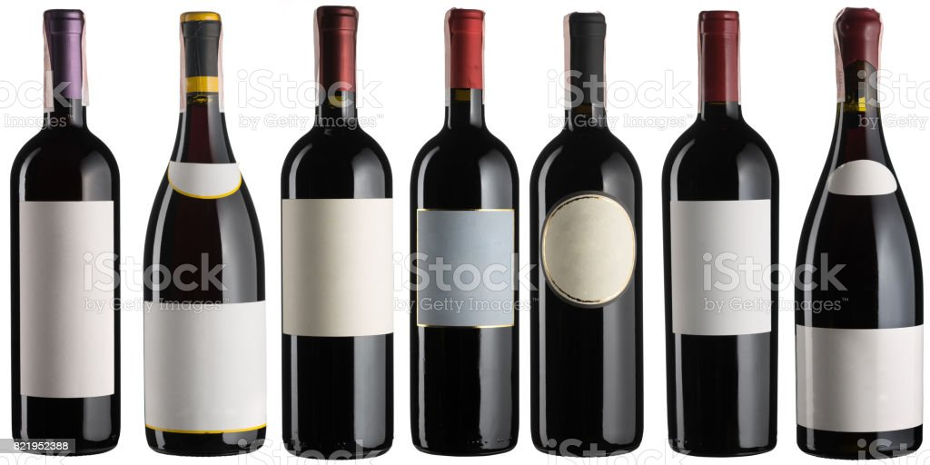 Set of multiple red wine bottles isolated on white stock photo
