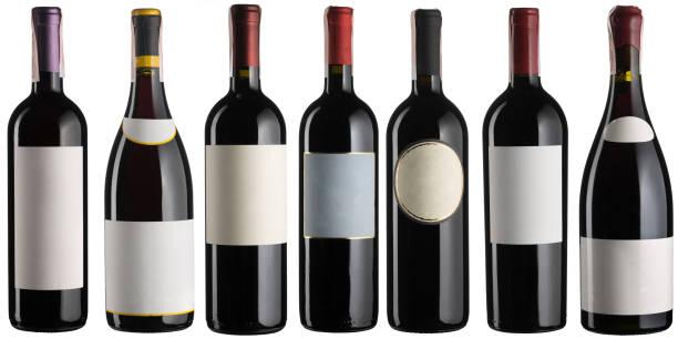 Set of multiple red wine bottles isolated on white stock photo