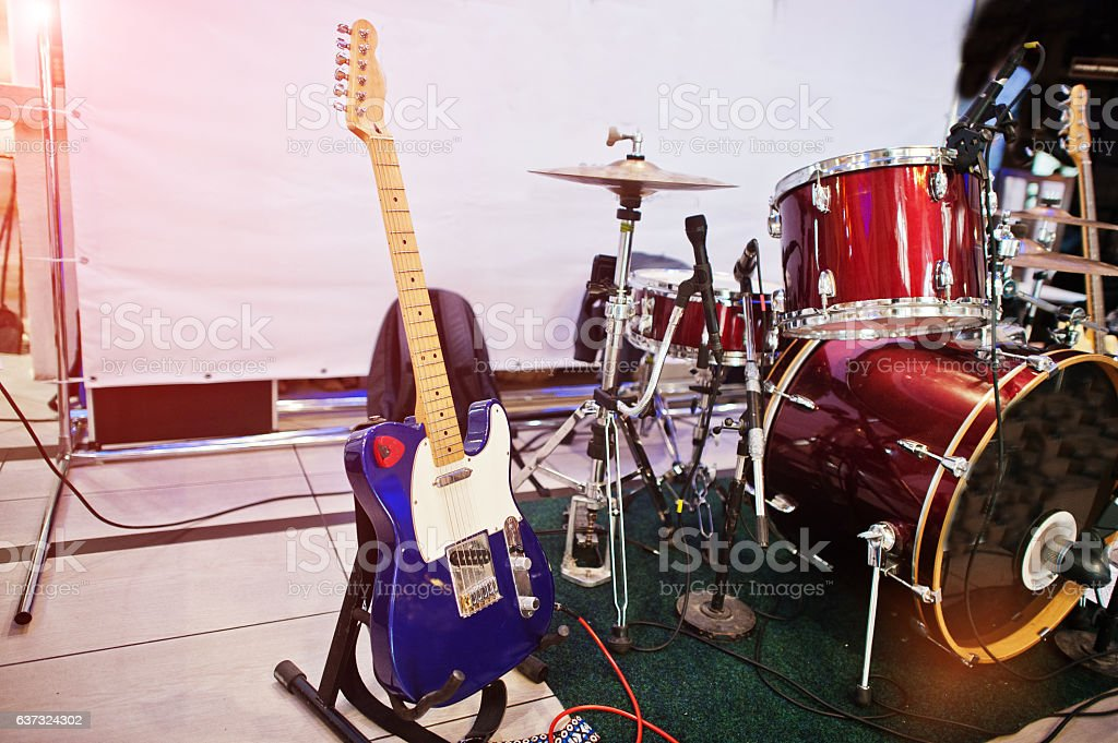 Set of musical instruments. Guitar and drums stock photo