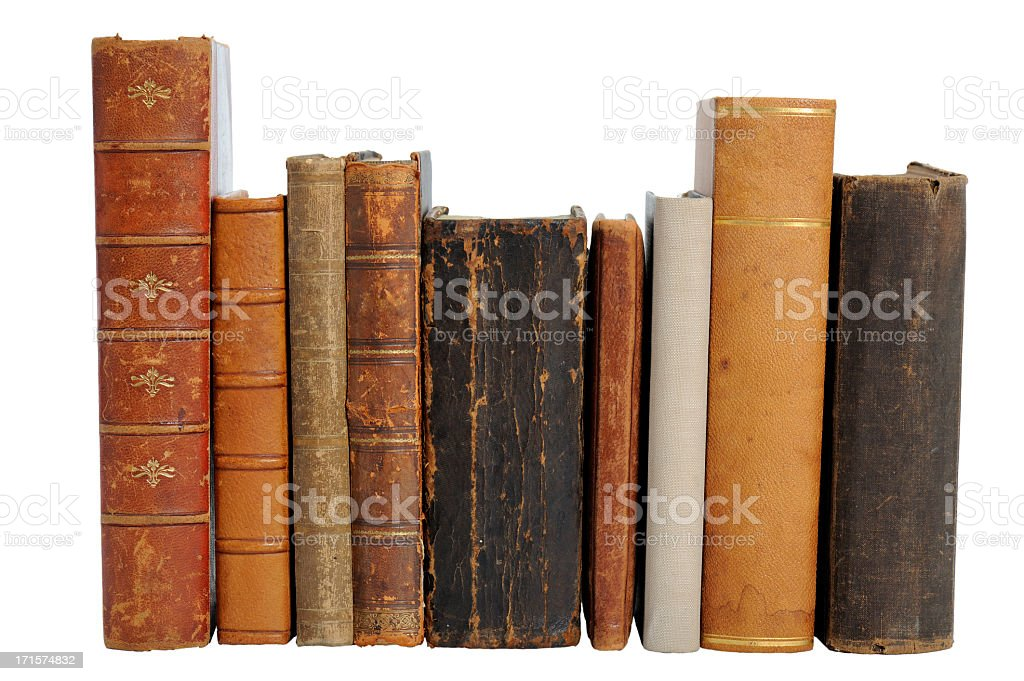 A set of nine antique books placed in a row stock photo
