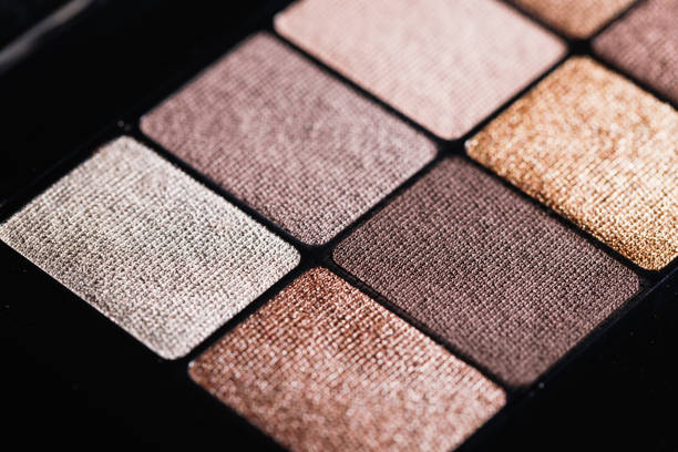 Set of nude mineral eyeshadow in a palette. Satin, matte  and metallic shades. stock photo