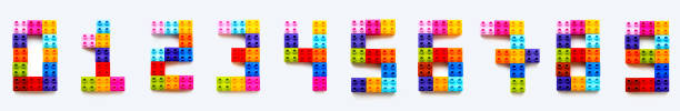 Set of numbers from 0 to 9 made of colorful constructor blocks. Toy bricks lying in order from zero to nine. Education process - learning numbers with child using multicolored toy details. stock photo