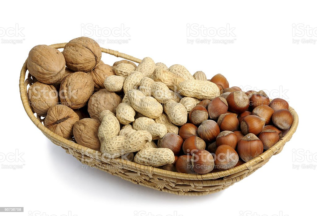 Set of nuts in a wicker basket, isolation royalty-free stock photo