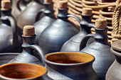 A set of jugs, bottles and pots for wine or oil. Antique vessels and pitchers on the shelves in the kit.